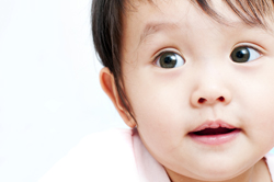 Cute close up of baby girl 250px