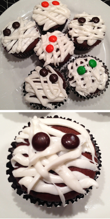 mummy cupcakes. Easy enough, just 'draw' lines on the cupcakes ...