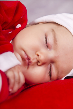 christmas baby sleeping 250