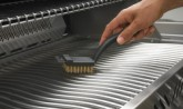 grill brush_in_use-napoleon-grills copy